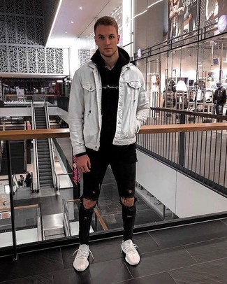 How to wear: white athletic shoes, black ripped skinny jeans, black hoodie, grey denim jacket