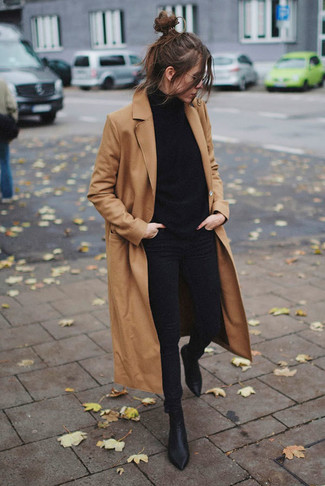How to wear: black leather ankle boots, black skinny jeans, black turtleneck, camel coat