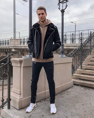 How to wear: white athletic shoes, black ripped skinny jeans, brown hoodie, black shearling jacket