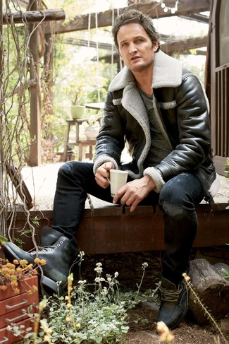 How to wear: black leather casual boots, black ripped skinny jeans, charcoal crew-neck t-shirt, black shearling jacket