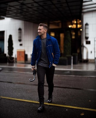 How to wear: black leather casual boots, black skinny jeans, charcoal crew-neck t-shirt, blue varsity jacket