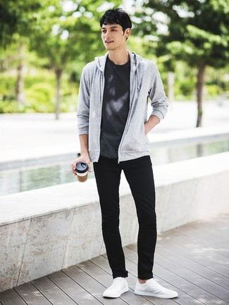 How to wear: white low top sneakers, black skinny jeans, charcoal crew-neck t-shirt, grey hoodie