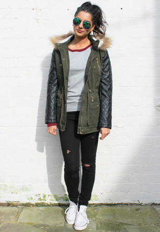 How to wear: white canvas high top sneakers, black ripped skinny jeans, grey crew-neck sweater, dark green leather parka