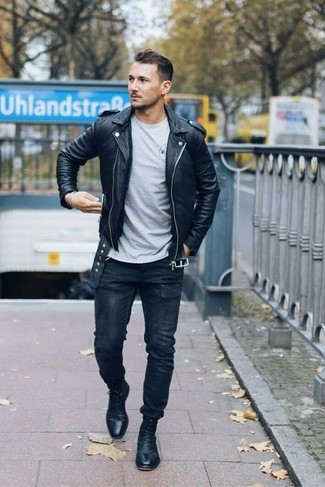 How to wear: black leather dress boots, black skinny jeans, grey crew-neck t-shirt, black leather biker jacket