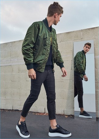 How to Wear Black Leather Low Top Sneakers For Men: We're loving how well a dark green bomber jacket pairs with black skinny jeans. Our favorite of a countless number of ways to round off this outfit is black leather low top sneakers.