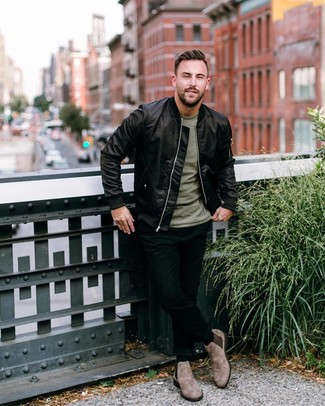 How to wear: brown suede chelsea boots, black skinny jeans, olive crew-neck t-shirt, black satin bomber jacket