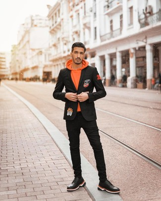 How to wear: black leather athletic shoes, black skinny jeans, orange hoodie, black embroidered blazer