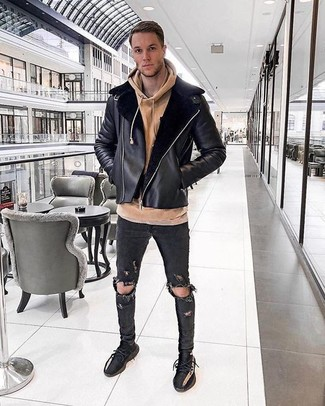 How to wear: black athletic shoes, black ripped skinny jeans, tan hoodie, black shearling jacket