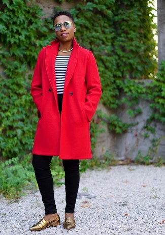 How to wear: gold leather loafers, black skinny jeans, white and navy horizontal striped crew-neck t-shirt, red coat