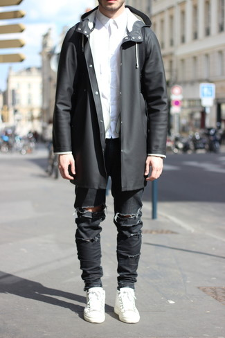 How to wear: white leather low top sneakers, black ripped skinny jeans, white dress shirt, black raincoat