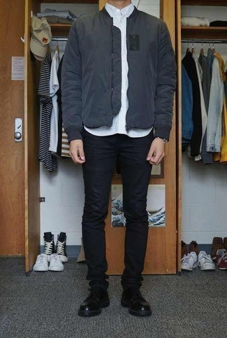 How to Wear Black Skinny Jeans For Men: For an outfit that's pared-down but can be manipulated in a ton of different ways, consider pairing a charcoal bomber jacket with black skinny jeans. Complement your outfit with a pair of black leather derby shoes to instantly spice up the ensemble.