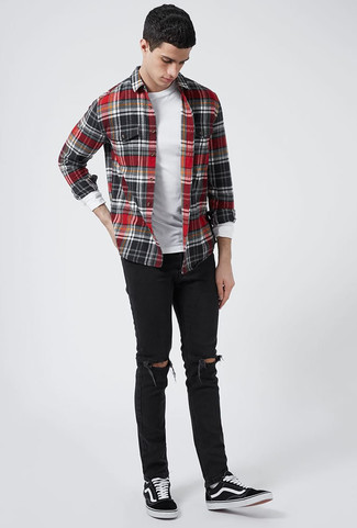 How to wear: black canvas low top sneakers, black ripped skinny jeans, white long sleeve t-shirt, red and black check flannel long sleeve shirt