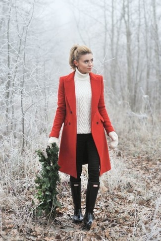 How to wear: black rain boots, black skinny jeans, white knit turtleneck, red coat