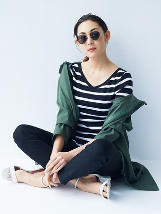 How to wear: white leather heeled sandals, black skinny pants, black and white horizontal striped v-neck t-shirt, dark green raincoat