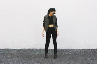 How to wear: black leather knee high boots, black skinny pants, black cropped top, olive anorak