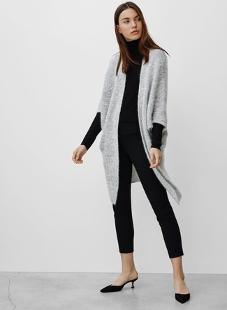 How to Wear Black Satin Mules: A grey knit open cardigan and black skinny pants are the kind of a no-brainer off-duty ensemble that you so desperately need when you have no time. Black satin mules are a fail-safe way to infuse an added touch of class into your outfit.
