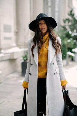 How to wear: black wool hat, black skinny pants, mustard knit turtleneck, grey coat