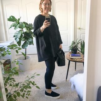 How to wear: black leather tote bag, black slip-on sneakers, black leggings, black oversized sweater