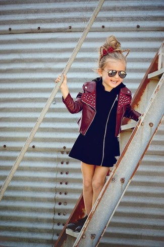 How to wear: black sneakers, black dress, burgundy leather jacket