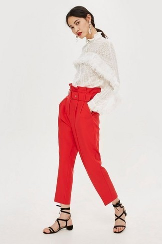 How to Wear a White Lace Long Sleeve Blouse: This pairing of a white lace long sleeve blouse and red tapered pants makes for the perfect base for a ton of combinations. You can get a bit experimental when it comes to shoes and make black suede gladiator sandals your footwear choice.