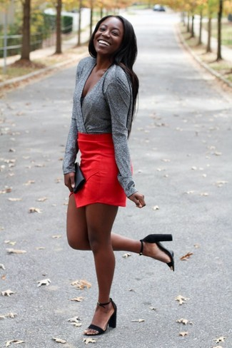 How to wear: black suede heeled sandals, red mini skirt, grey long sleeve blouse