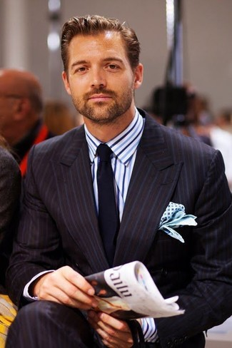 How to wear: black vertical striped suit, white and blue vertical striped dress shirt, navy tie, white and blue print pocket square