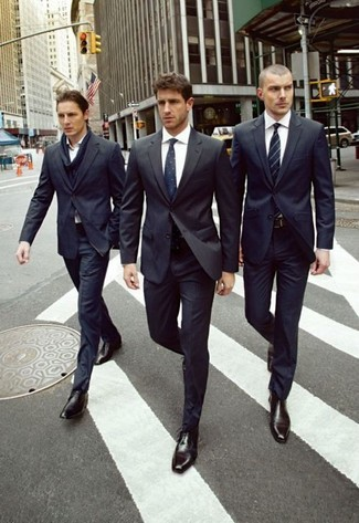 How to wear: black suit, white dress shirt, black leather derby shoes, navy embroidered tie