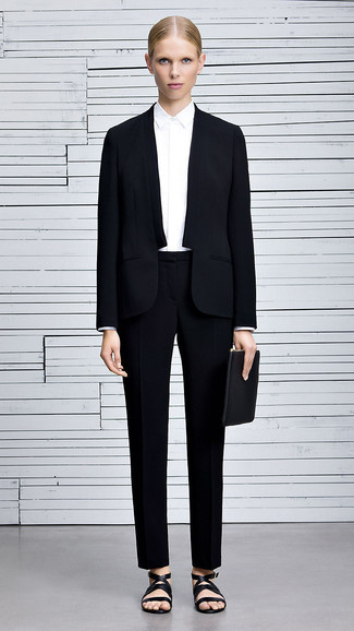 Wear a white dress shirt with a pantsuit for a stylish and sophisticated look. A pair of black leather flat sandals will be a stylish addition to your outfit.
