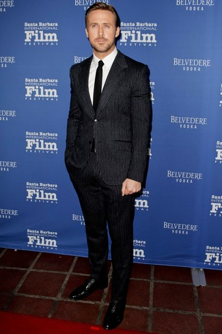 Ryan Gosling wearing Black Vertical Striped Suit, White Dress Shirt, Black Leather Oxford Shoes, Black Tie