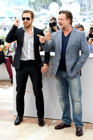 Ryan Gosling wearing Black Suit, White Vertical Striped Long Sleeve Shirt, Black Leather Loafers, Black Sunglasses