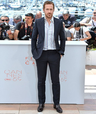 Ryan Gosling wearing Black Suit, White Vertical Striped Long Sleeve Shirt, Black Leather Loafers