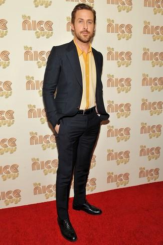 50cfec2da538 Ryan Gosling wearing Black Suit, Yellow Short Sleeve Shirt, Black ...