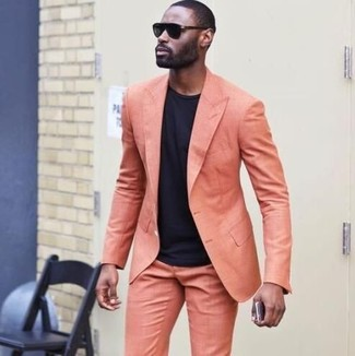 How to wear: black sunglasses, black crew-neck t-shirt, orange suit