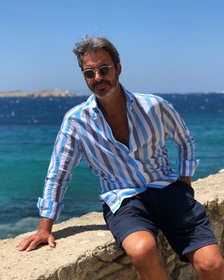 How to wear: black sunglasses, navy shorts, light blue vertical striped long sleeve shirt