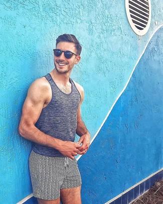 How to wear: black sunglasses, white and black print swim shorts, charcoal tank