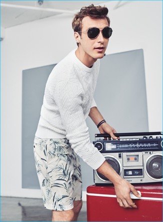 How to wear: black sunglasses, white print shorts, white cable sweater