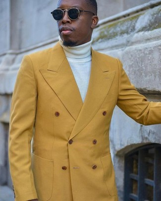 How to wear: black sunglasses, white turtleneck, mustard double breasted blazer