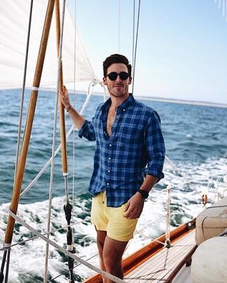 How to wear: black sunglasses, yellow swim shorts, navy plaid long sleeve shirt