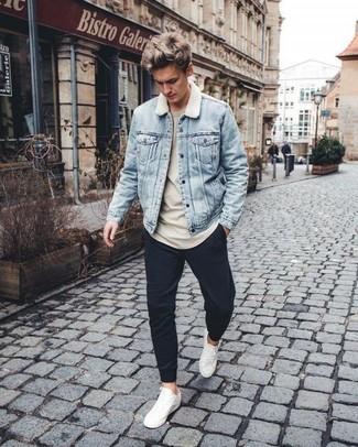 How to wear: white leather low top sneakers, black sweatpants, beige sweatshirt, light blue denim jacket