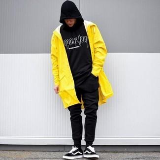 How to wear: black suede low top sneakers, black sweatpants, black and white print hoodie, yellow raincoat