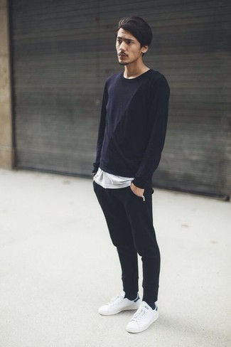 How to wear: white leather low top sneakers, black sweatpants, grey crew-neck t-shirt, black long sleeve t-shirt