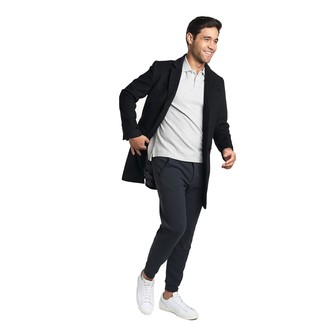 How to wear: white leather low top sneakers, black sweatpants, grey polo, black overcoat