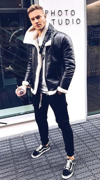 How to wear: black and white canvas low top sneakers, black sweatpants, grey print sweatshirt, black and white shearling jacket