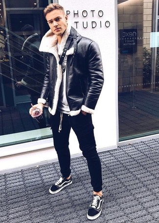 How to wear: black low top sneakers, black sweatpants, grey print sweatshirt, black shearling jacket