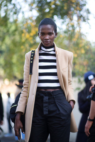 How to wear: black canvas crossbody bag, black tapered pants, white and black horizontal striped cropped sweater, camel coat