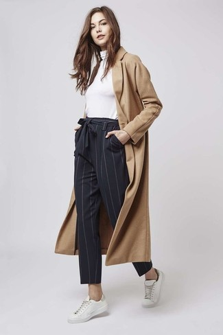 How to wear: white low top sneakers, black vertical striped tapered pants, white turtleneck, camel coat
