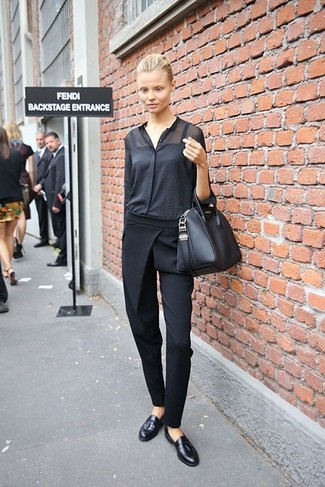 How to wear: black leather tote bag, black leather tassel loafers, black tapered pants, black button down blouse