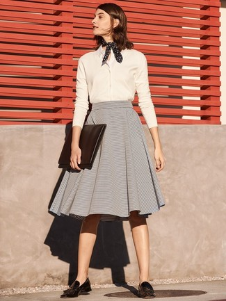How to Wear a Grey Full Skirt: This pairing of a white dress shirt and a grey full skirt brings comfort and confidence and helps keep it low-key yet modern. A pair of black leather tassel loafers will tie the whole thing together.