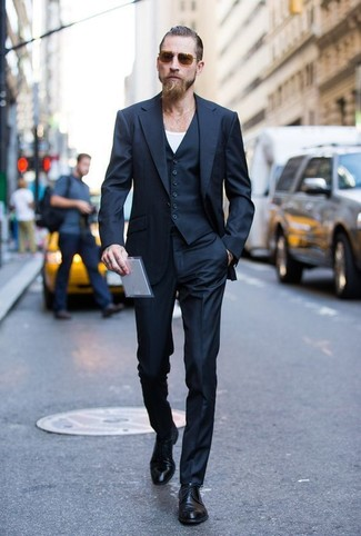 A Smart Casual Combination Of A Black And Blue Three Piece Suit And A White Crew