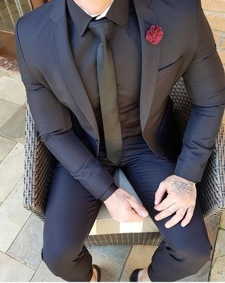 How to wear: red lapel pin, black tie, black dress shirt, black suit